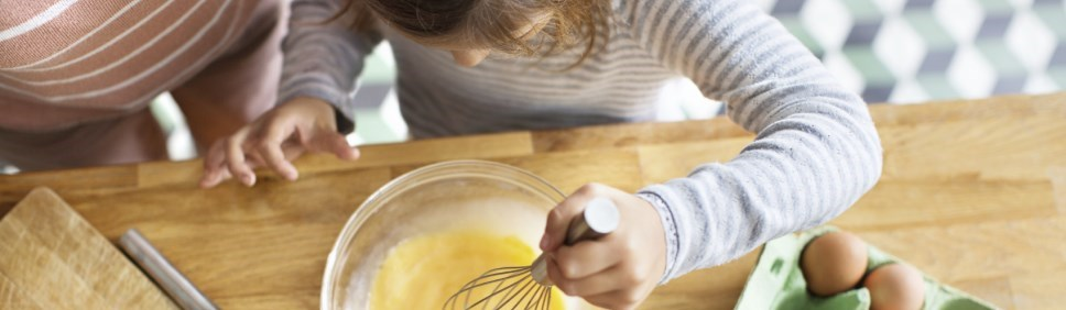 young girl mixing eggs