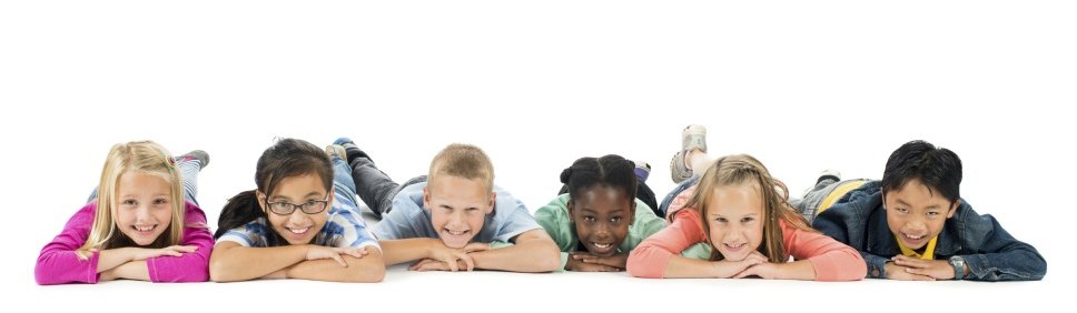 group of kids lying on their stomachs with crossed arms